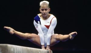 Image of a Former U.S Gymnast Shannon Miller - Performing Against Cancer.