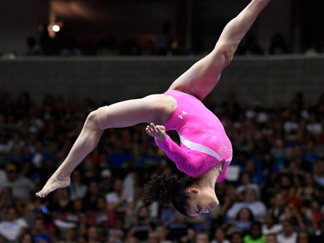 A girl gymnast doing reciprocal dive in the air