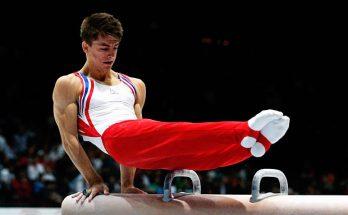 Male Gymnast doing pommal horse