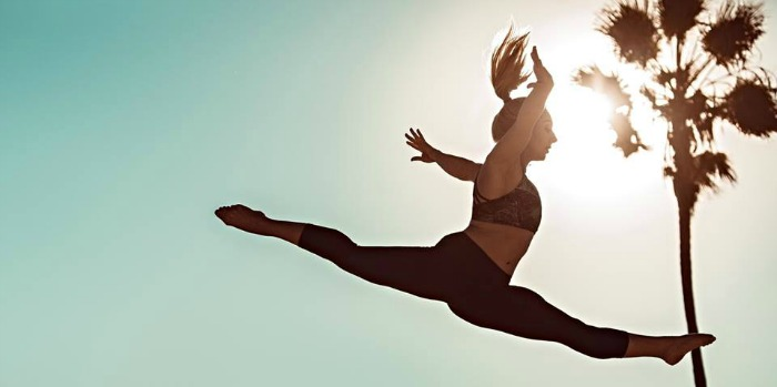 Image showing a girl gymnast oracticing in a sunny day
